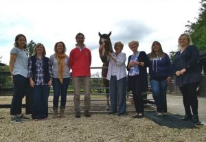 A group shot with Jan Fennell and a horse